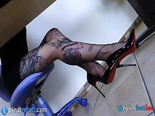 Secretary In Pantyhose Takes Off Her High Heels
