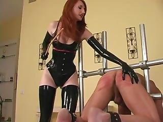 Redhead Mistress In Latex