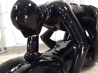 2 Lesbian Mastubed In Latex Catsuit With Stapon