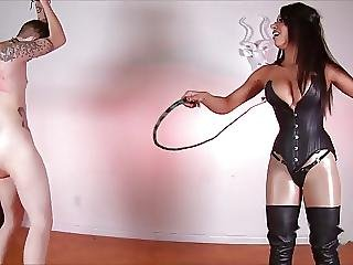 Brunette Mistress With Singletail Whipping Her Slave