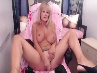 Mature Busty Blonde Enjoying A Toy