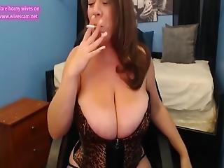 Busty Milf Sucks Both Nipples And Deepthroats Dildo