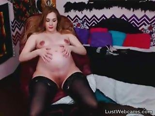 Sexy pregnant babe teasing on webcam