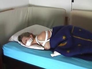 Young Blonde Girl Wakes Up Stripped And Tied, Struggles To Get Free