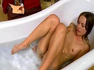 Horny Coed Testing Glass Dildo In Bath