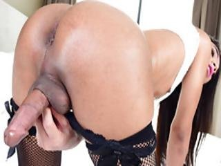 Asian Ladyboy Meen Assfucks Herself With A Toy