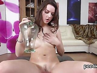 Enchanting Sweetie Is Pissing And Fingering Shaved Snatch
