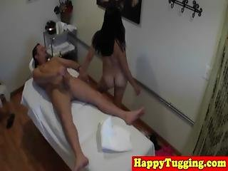 Chubby Asian Tugging Masseuse Gives Handjob