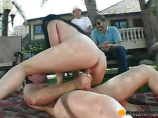 Brunette Fucks With The Guy Lying On The Grass
