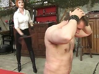 Sexy Redhead Mistress Whipping Stiletto Boots