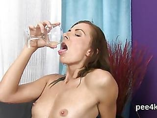 Fantastic Girl Is Pissing And Finger Fucking Shaven Twat