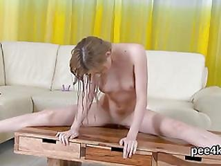 Enchanting Nympho Is Pissing And Rubbing Smooth Pussy