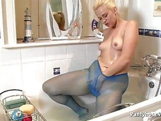 Pantyhose Babe Rubs Pussy In Bathroom