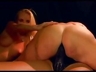 Three Lesbians In A Dungeon With A Strapon