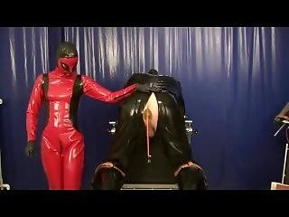 Punishment The Rubber Slave Anal Treatment With Plugs Strap On Latex Femdom