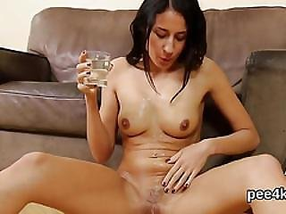 Beautiful Girl Is Pissing And Pleasuring Smooth Muff