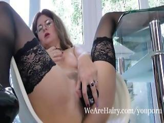 Elena V Masturbates With Her Black Dildo In Chair