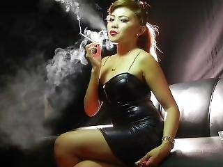 Smoking Asian In Black Pvc Minidress