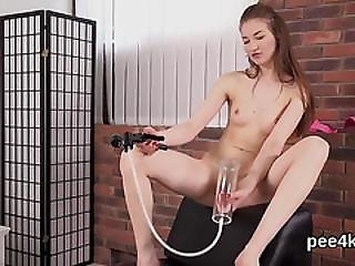 Glamorous Cutie Is Pissing And Rubbing Shaved Twat