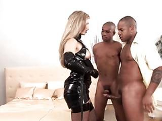 Katy Caro Is In Charge. A Horny Dominatrix, She Uses Her Two Black