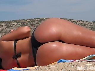 Bubble Ass Candid Beauty Sunbathing In Public Beach Wearing Thong Bikini!