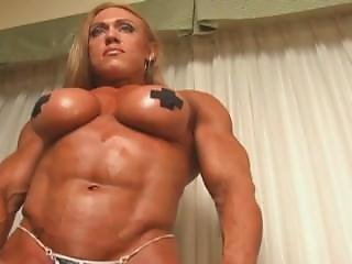 Beautiful Female Bodybuilder Posing And Flexing In Skimpy Outfit With Oil