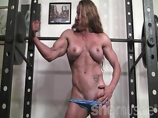 Ripped Female Bodybuilder Ironfire Works Out And Poses In The Gym