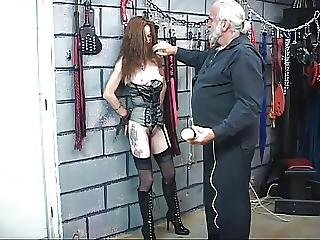 A Sexy Redhead In A Corset Gets Played With And Disciplined