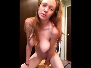 Redhead With Fantastic Tits Riding Dildo