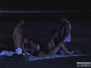 Foursome At Night, On The Beach