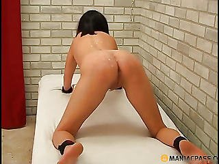On The Body Of A Naked Brunette Pours Wax