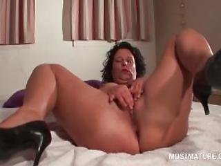 Mature Hottie Spreads Legs And Rubs Pussy