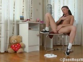 A Young Girl Sits And Masturbates While Studying