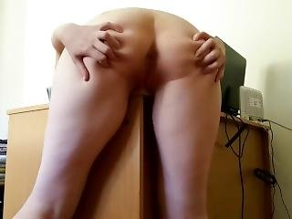 Little Redhead Rubs Against A Desk And Cums Hard