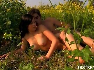 Curvy Brunette Fucks In A Flower Field