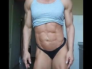 Female Bodybuilder Poses Provocatively, Almost Flashes Shaved Pussy