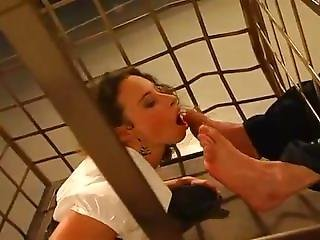 Pretty Caged Secretary Girl Worships Feet Of A Man
