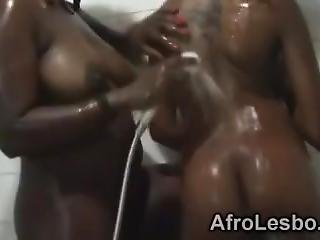 Ebony Babes Engage Into Lesbian Action At The Bathroom