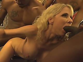 Busty Blonde Cougar Is Very Happy To Feel Multiple Black Dicks Surrounding Her