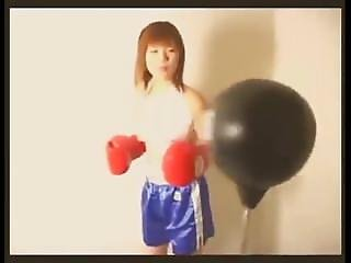Topless Japanese Girl Working The Bag