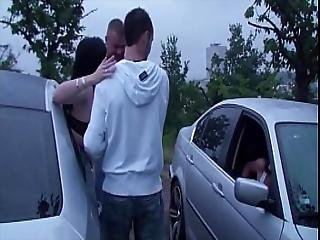 A Girl Is Undressing In A Car On The Way To A Public Sex Gang Bang Dogging Orgy