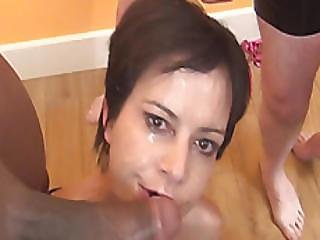 Short Haired Babe Gets Cum On Face In Bukkake