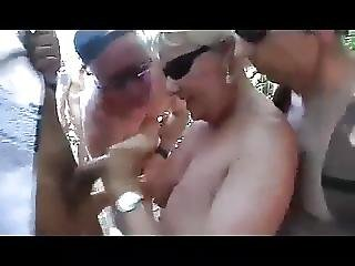 Granny At The Beach Sucking Every Cock She See