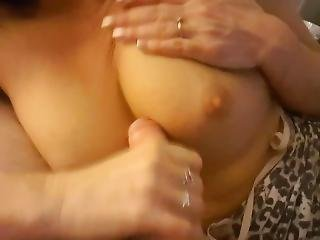 Busty Milf Jerks A Thick Cock To Get A Huge Load Between Her Tits