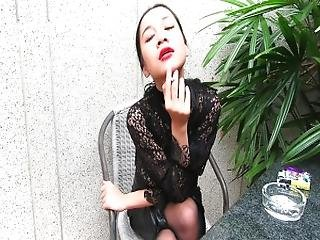 Vrpussyvision.com   Young Girl Smokes Topless And In Leather Skirt