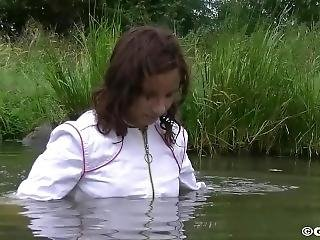 Girl With Fully Clothes Swims In Lake