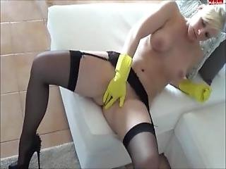 Milf Doing Dishes Gets Horny And Plays With Herself In Gloves