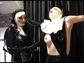 Two Nuns In Rubber Having Fun