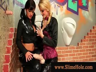 Girls Wearing Strapons Making Out While Sprayed With Goo