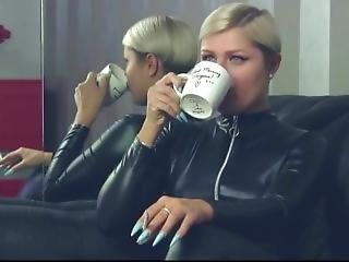 Lady With Long Nails Smoking In Pvc Catsuit